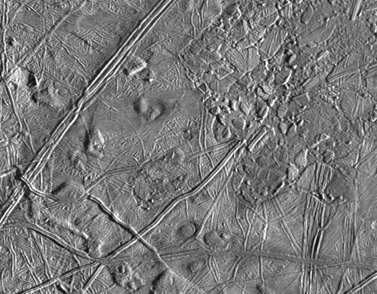 The complex terrain of Jupiter's moon, Europa was taken by NASA's Galileo's Solid State Imaging system from a distance of 17,900 kilometers (11,100 miles) on the spacecraft's sixth orbit around Jupiter, on February 20, 1997.