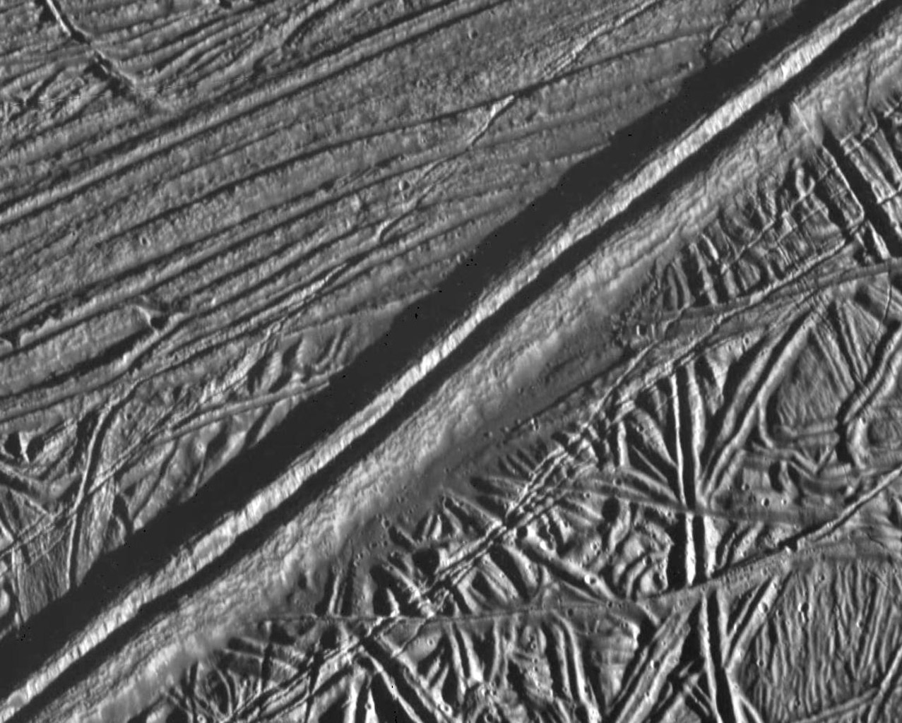 This view of the icy surface of Jupiter's moon, Europa, is a mosaic of two pictures taken by the Solid State Imaging system on board NASA's Galileo spacecraft during a close flyby of Europa on February 20, 1997.