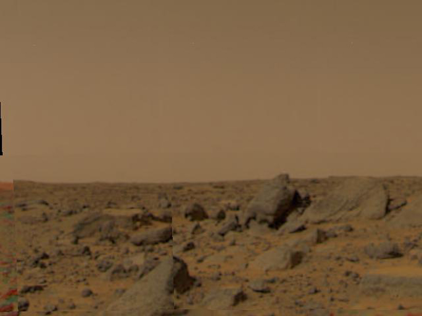 Large boulders are visible in this enlargement of pictures taken by the Imager for NASA's Mars Pathfinder (IMP) lander camera on July 4, 1997.