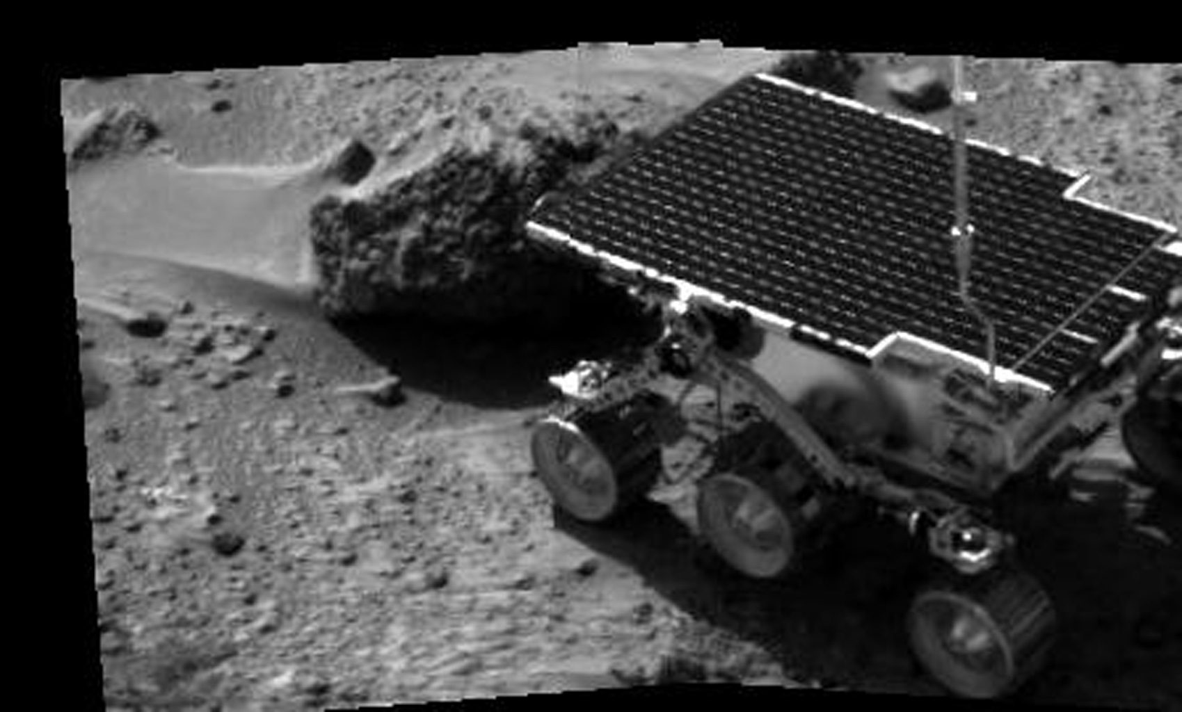 NASA's Sojourner's first analysis of a rock on Mars began on Sol 3 with the study of Barnacle Bill, a nearby rock named for its rough surface. The image was taken by the Imager for Mars Pathfinder (IMP) after its deployment on Sol 3.