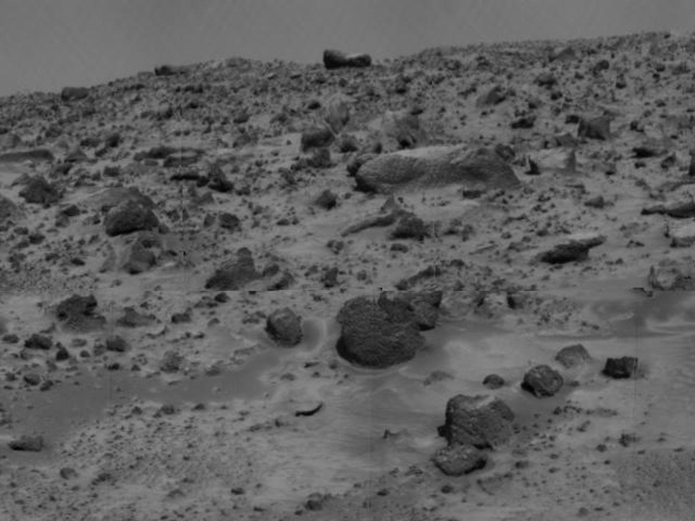 This view of the rock on Mars dubbed 'Couch' was taken by NASA's deployed Imager for Mars Pathfinder (IMP) on July 7, 1997.