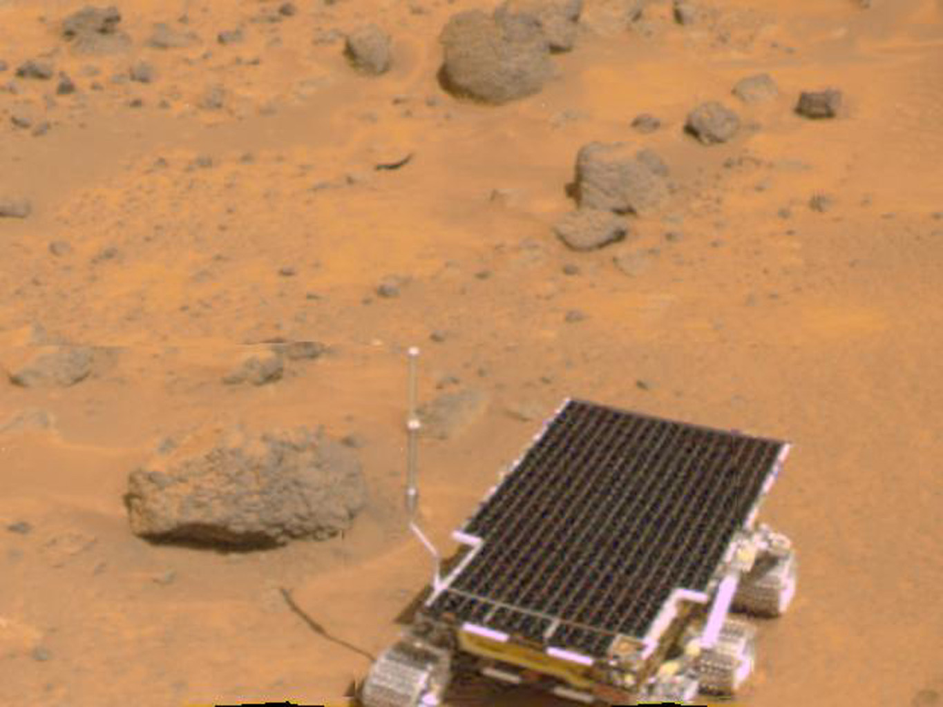 The Mars rover Sojourner is visible in this color image, one of the first taken by the deployed NASA's Imager for Mars Pathfinder (IMP) on July 7, 1997.