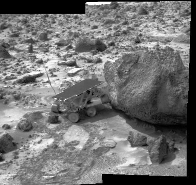 Sojourner made contact with the rock 'Yogi' in this image, along with the lander's deflated airbags, were imaged by NASA's Imager for Mars Pathfinder (IMP) on July 10, 1997.The rover's left rear wheel has driven up onto the Yogi's surface.