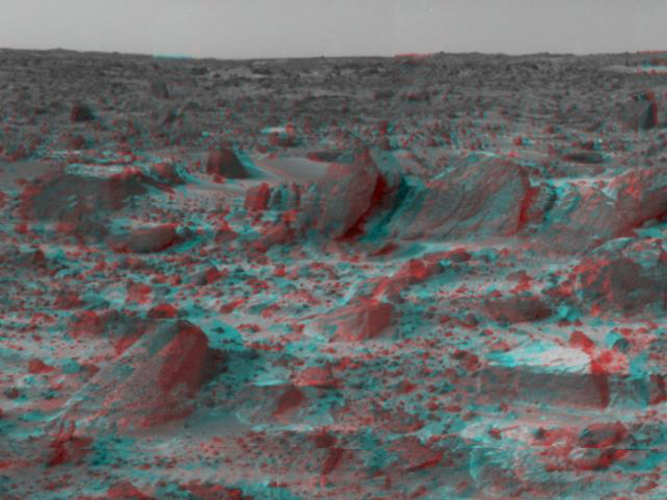 Many prominent rocks near the Sagan Memorial Station are featured in this image from NASA's Mars Pathfinder. 'Shark', 'Half-Dome', and 'Pumpkin' are at center 3-D glasses are necessary to identify surface detail.