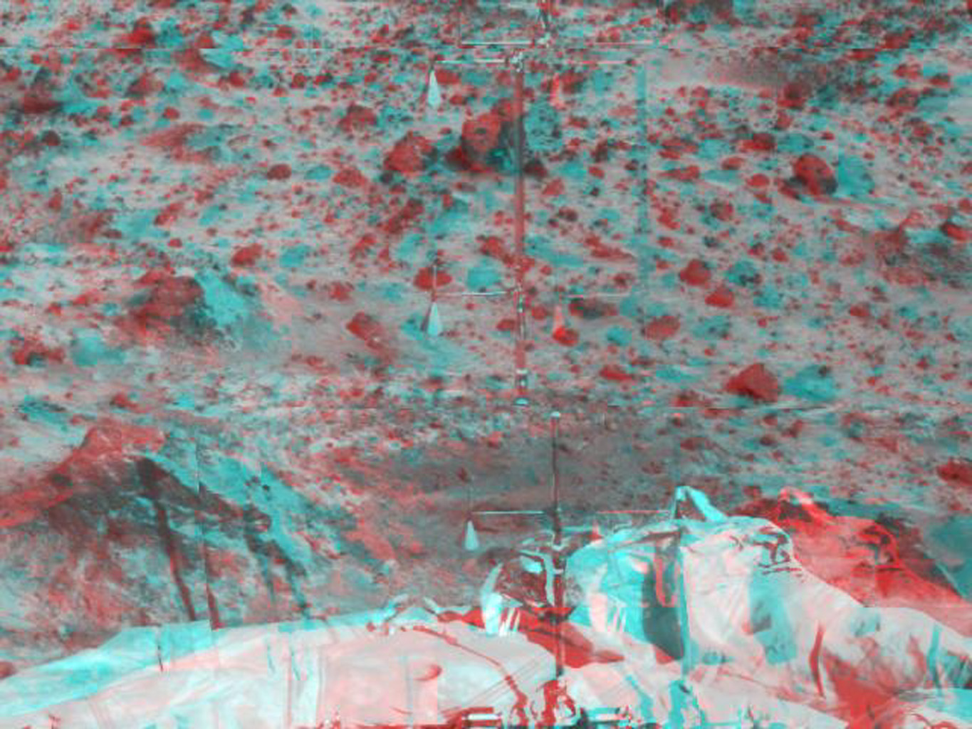 The Atmospheric Structure Instrument/Meteorology Package (ASI/MET) is the mast and windsocks at the center of this stereo image from NASA's Mars Pathfinder. 3-D glasses are necessary to identify surface detail.