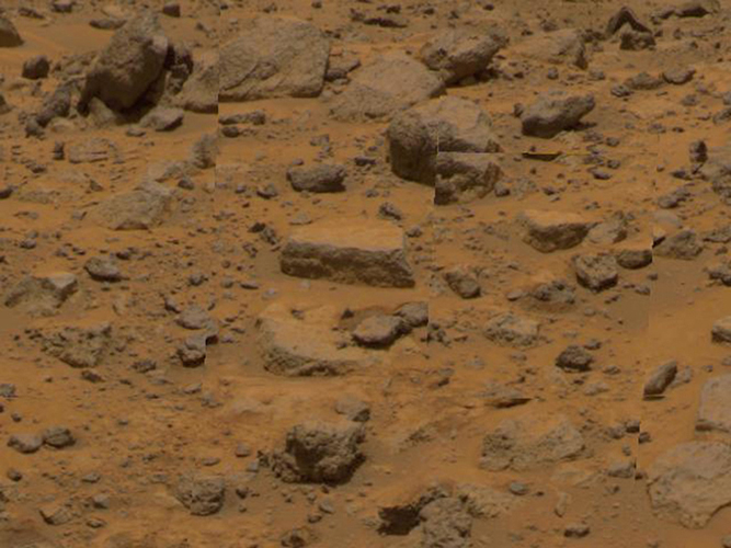 Taken by NASA's Imager for Mars Pathfinder (IMP), this image shows the rock dubbed 'Flat Top' at center. Dust has accumulated on the top of Flat Top, but is not present on the sides due to the steep angles of the rock.