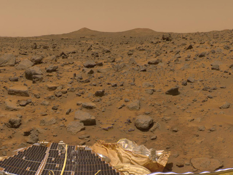The prominent hills dubbed 'Twin Peaks' were imaged by NASA's Imager for Mars Pathfinder (IMP) as part of a 360-degree color panorama, taken Jul. 13-14, 1997. A lander petal and deflated airbag are at the bottom of the image.