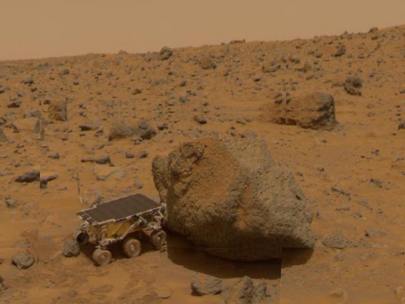 This 1997 image from NASA's Mars Pathfinder shows a close up of Sojourner as it placed its Alpha Proton X-Ray Spectrometer (APXS) upon the surface of the rock 'Yogi.'