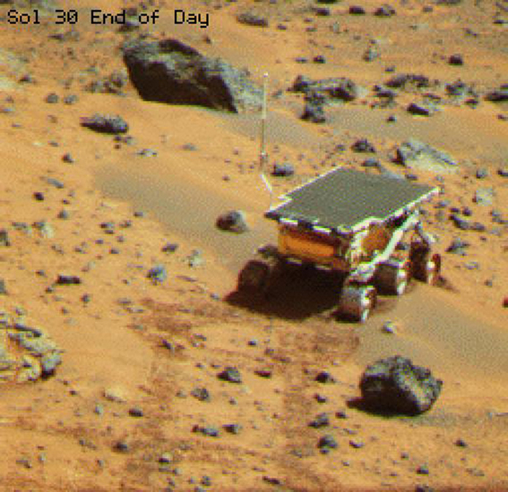 This is an image of NASA's rover Sojourner at the feature called Mermaid Dune at the MPF landing site. Mermaid is thought to be a low, transverse dune ridge, with its long (approximately 2 meters) axis transverse to the wind.