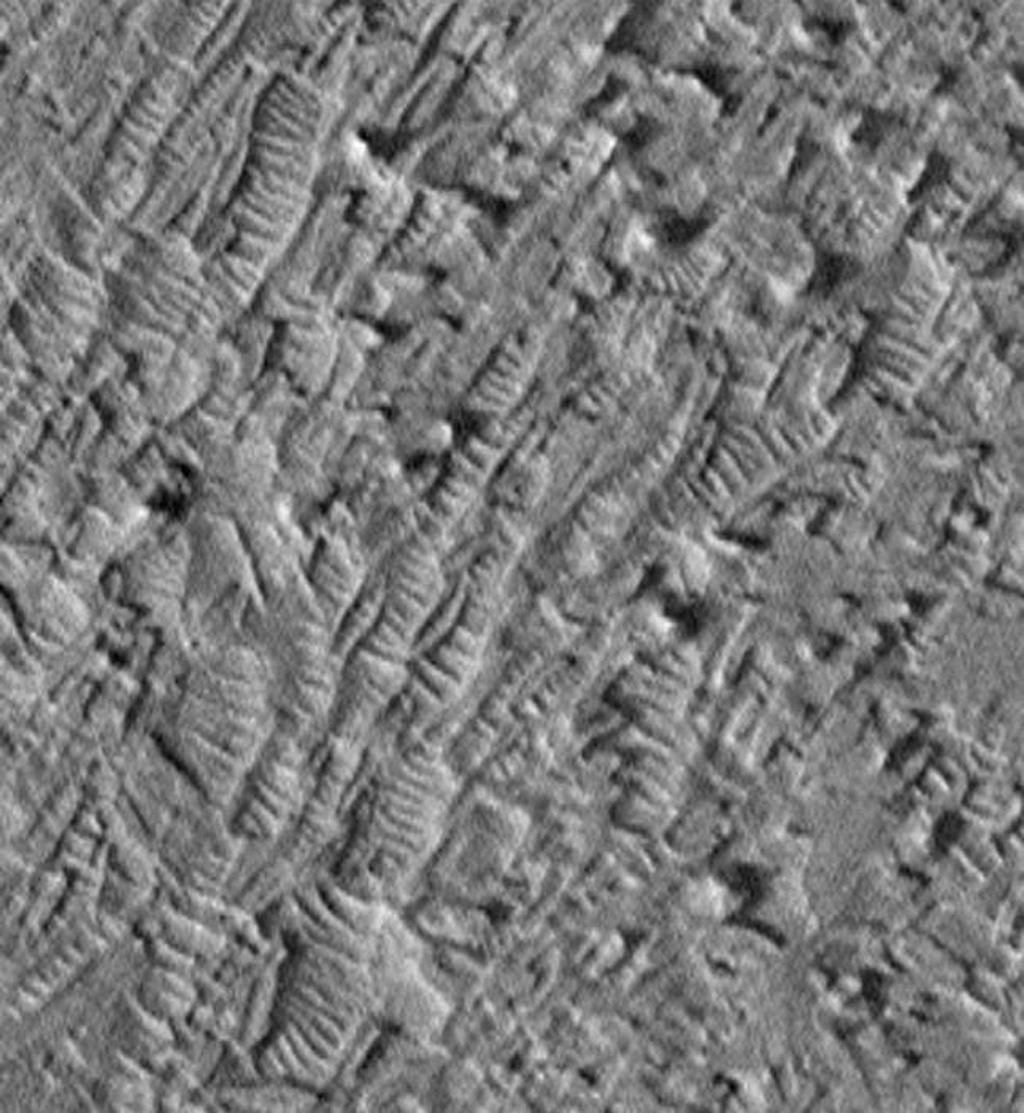 Dunes in etch pits and troughs in Crommelin Crater in the Oxia Palus area. This 3.2 x 3.5 km image (frame 3001) is centered near 4.1 degrees north, 5.3 degrees west, taken by NASA's Mars Global Surveyor Orbiter.