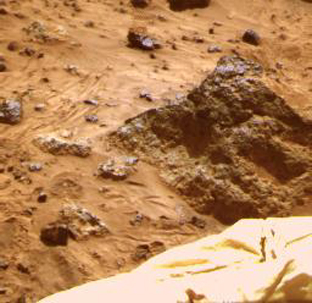 The 'Mini Matterhorn' is a 3/4 meter rock immediately east-southeast of NASA's Mars Pathfinder lander. This image shows a 'raw,' standard-resolution color frame of the rock. Sol 1 began on July 4, 1997.