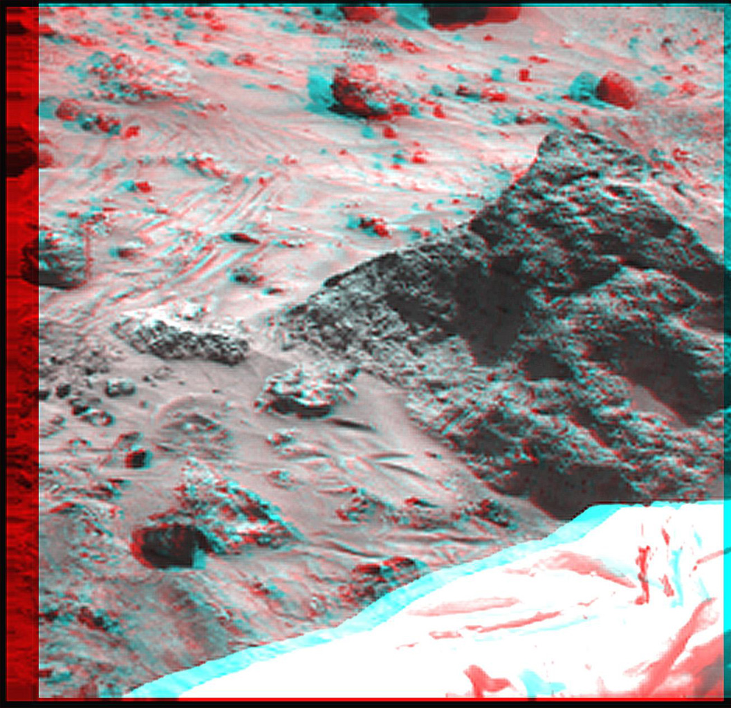 The 'Mini Matterhorn' is a 3/4 meter rock immediately east-southeast of NASA's Mars Pathfinder lander. 3D glasses are necessary to identify surface detail.
