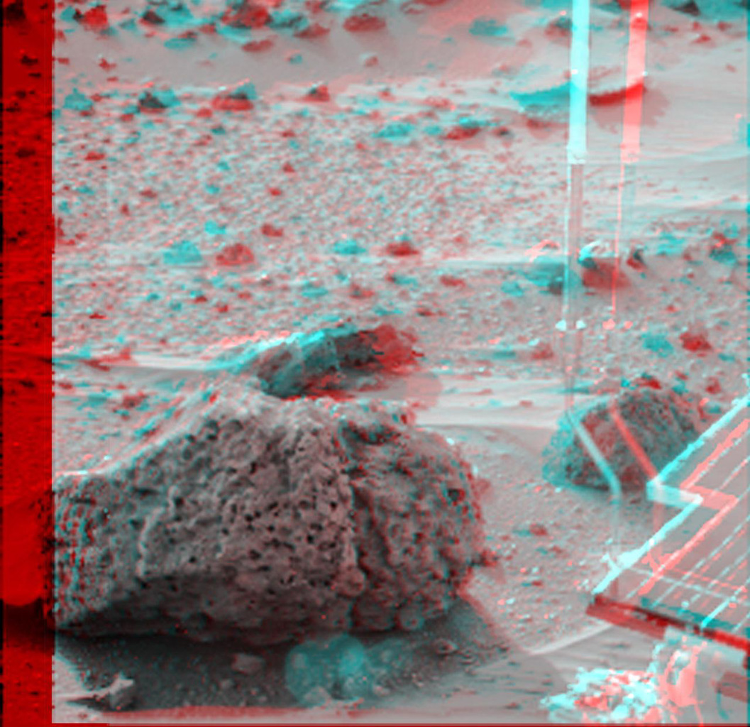'Barnacle Bill' is a small rock immediately west-northwest of NASA's Mars Pathfinder lander and was the first rock visited by the rover Sojourner. 3D glasses are necessary to identify surface detail.