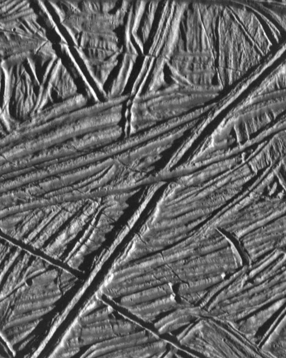 This high resolution image of the icy plains on Europa shows multiple sets of cross-cutting ridges. Many of these ridges   are cut by younger fractures. NASA's Galileo spacecraft obtained this image on February 20, 1997.