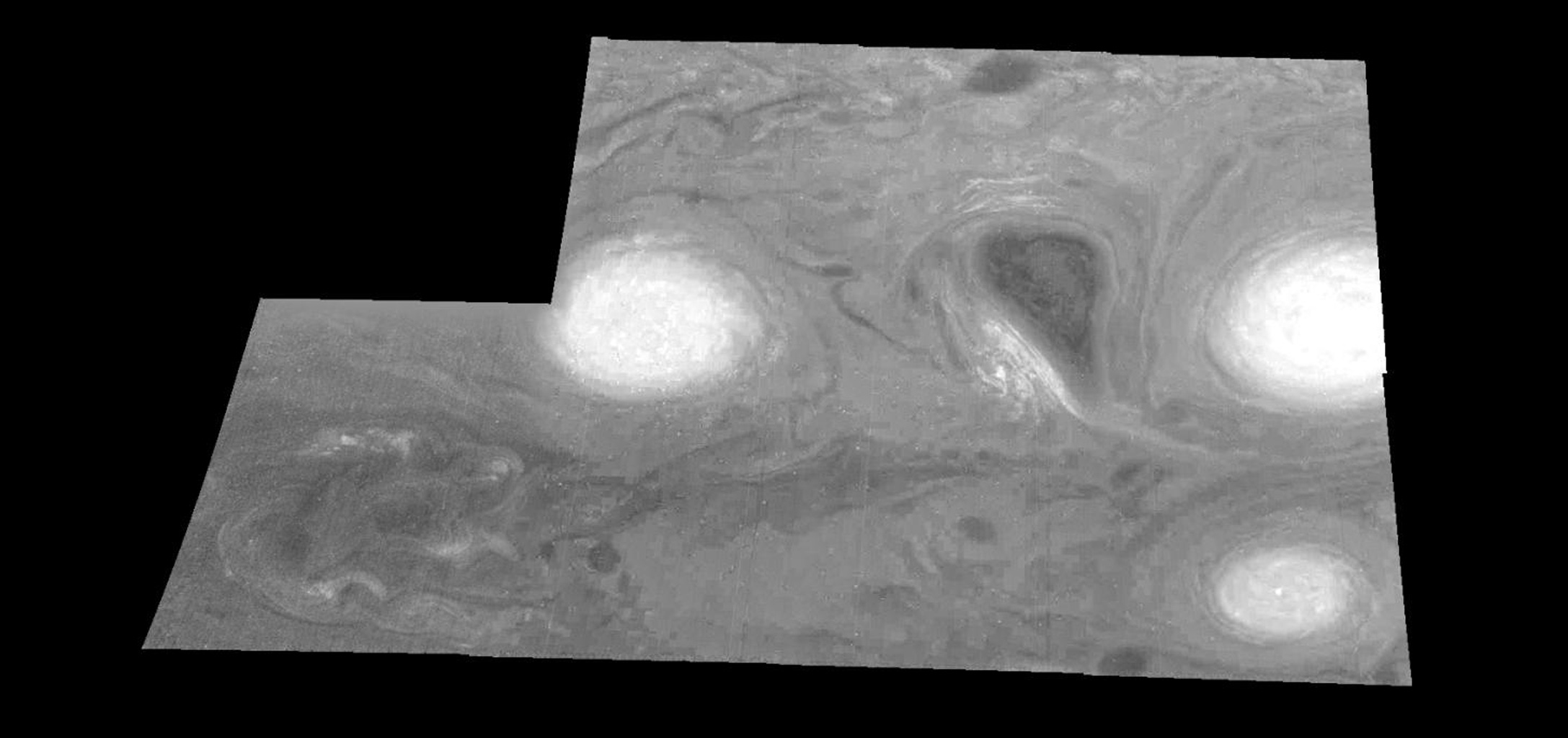 This mosaic shows the features of a hazy cloud layer tens of kilometers above Jupiter's main visible cloud deck as seen by NASA's Galileo orbiter on February 19, 1997.