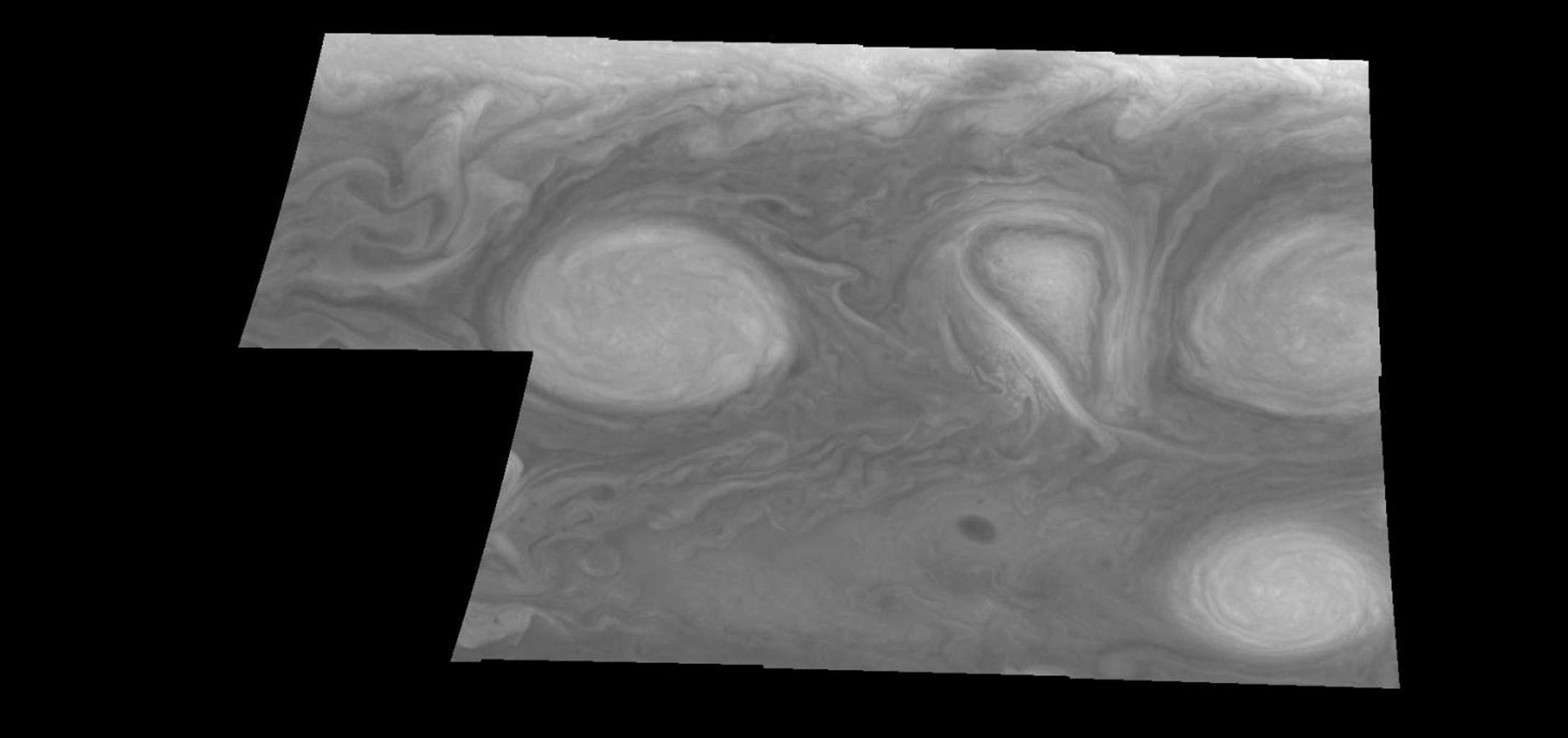 This mosaic shows the features of Jupiter's main visible cloud deck and upper-tropospheric haze, with higher features enhanced in brightness over lower features as seen by NASA's Galileo orbiter on February 19, 1997.