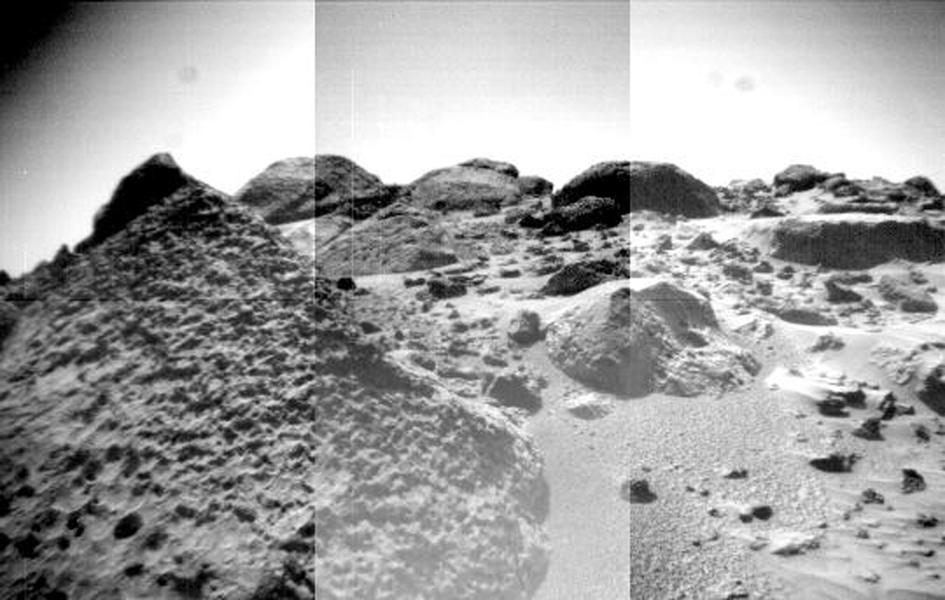 The front cameras aboard NASA's rover Sojourner imaged several prominent rocks on Sol 44. The highly-textured rock at left is Wedge, and in the background from left to right are 'Shark,' 'Half-Dome,' and 'Moe.' Sol 1 began on July 4, 1997.