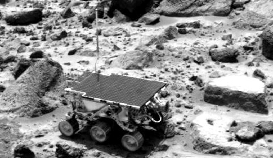 This image obtained by NASA's Imager for Mars Pathfinder (IMP) of the Sojourner rover was taken near the end of daytime operations on Sol 42. The rover is between the rocks 'Wedge' (left) and 'Flute Top' (right). Sol 1 began on July 4, 1997.