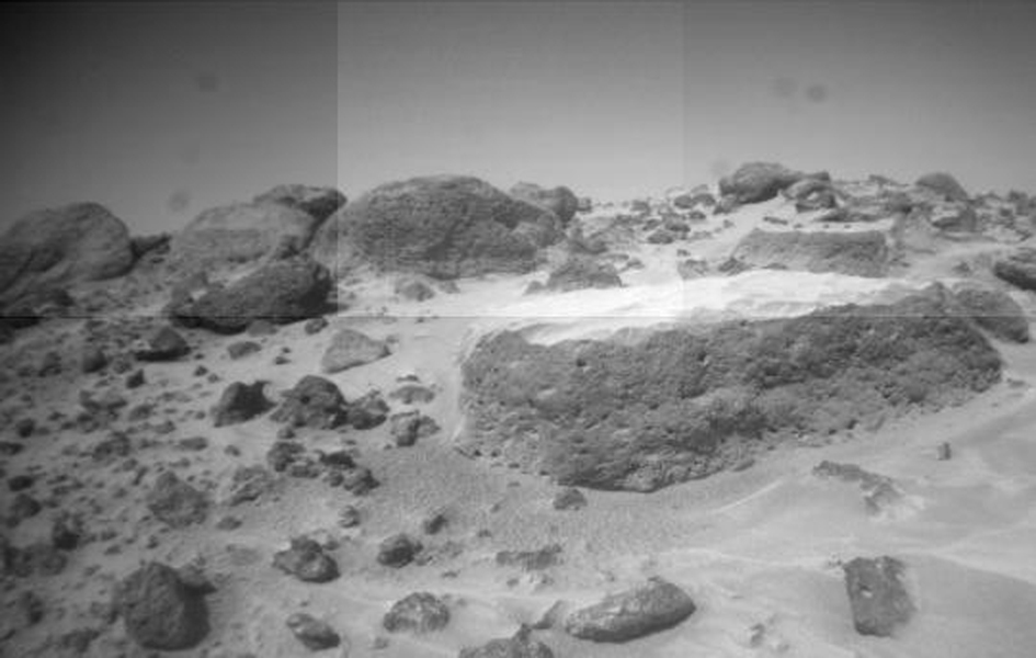 This image of the rock 'Flat Top' was taken from one of NASA's Sojourner rover's front cameras on Sol 42. Sol 1 began on July 4, 1997.