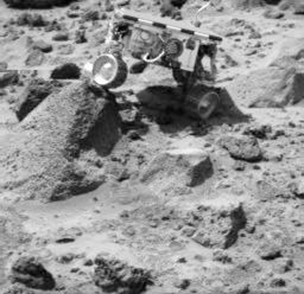 Sojourner's left rear wheel is perched on the rock 'Wedge' in this image, taken on Sol 47 by NASA's Imager for Mars Pathfinder (IMP). Sol 1 began on July 4, 1997.