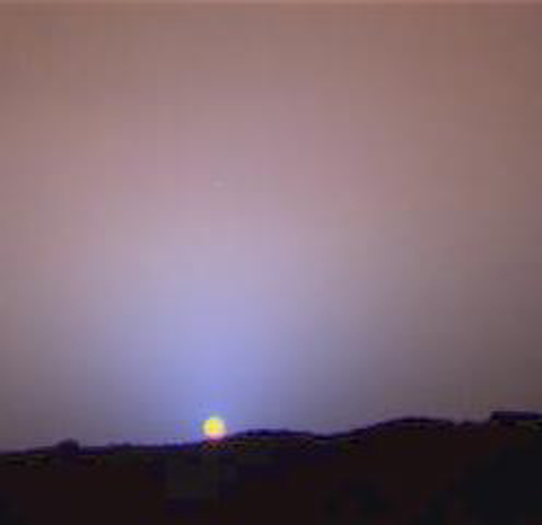 This is a close-up of the sunset on Sol 24 as seen by NASA's Imager for Mars Pathfinder (IMP). The red sky in the background and the blue around the Sun are approximately as they would appear to the human eye. Sol 1 began on July 4, 1997.