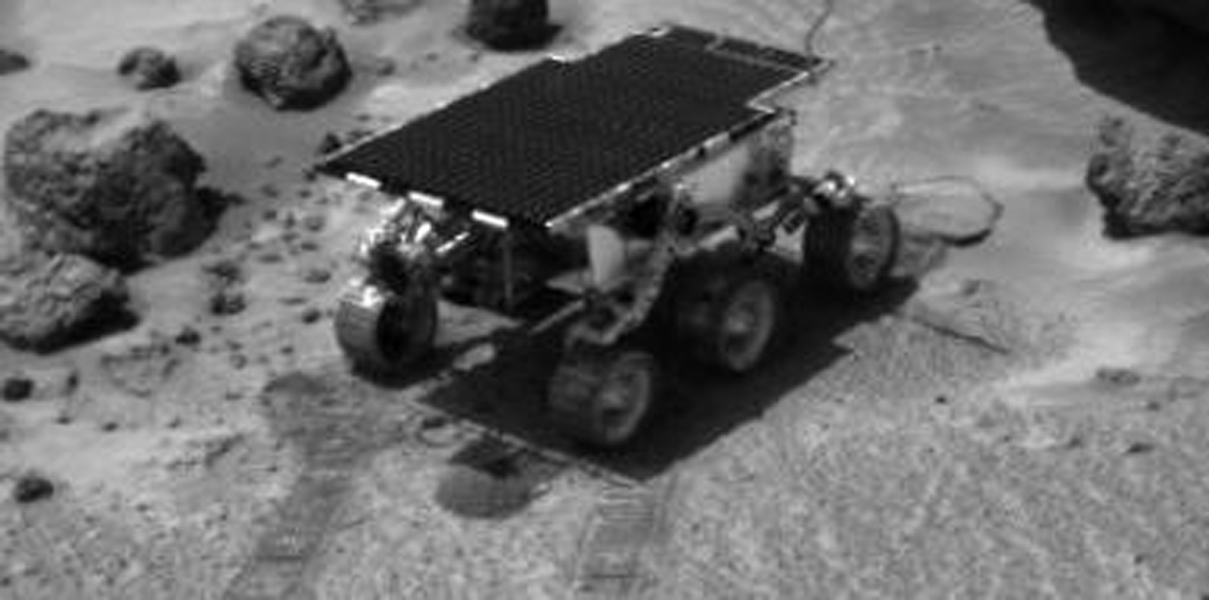 Sojourner, while on its way to the rock 'Yogi,' performed several soil mechanics experiments. Piles of loose material are seen in front of and behind the Rover. This image was taken by NASA's Imager for Mars Pathfinder (IMP). Sol 1 began on July 4, 1997.