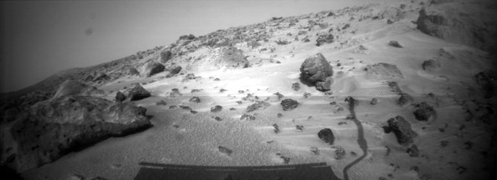 This image taken on Sol 74 ( September 17) from NASA's Sojourner rover's right front camera shows areas of the Pathfinder landing site never before seen. Sol 1 began on July 4, 1997.