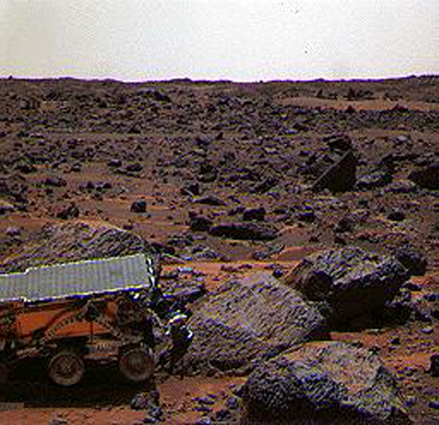 This color image shows NASA's Mars Pathfinder (MPF) Sojourner rover's Alpha Proton X-ray Spectrometer (APXS) deployed against the rock 'Moe' on the morning of Sol 65. This image was taken by NASA's Mars Pathfinder (MPF).