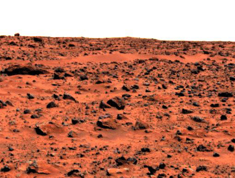 This enhanced color image of the Pathfinder landing site shows the eastern horizon. The elongated, reddish, low contrast region in the distance is 'Roadrunner Flats.' This image was taken by NASA's Mars Pathfinder (MPF).