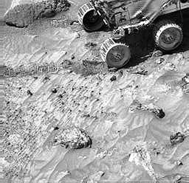 Pebbles are seen in lander images, along with cobbles. For example, this image taken by NASA's Imager for Mars Pathfinder (IMP) shows the same pebbles that were visible in the Sojourner rover image of the 'Cabbage Patch.' Sol 1 began on July 4, 1997.