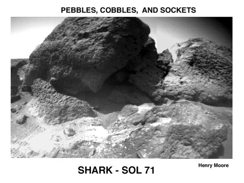 In 1997, NASA's Mars Pathfinder took this image of 'Shark' (upper left center), 'Half Dome' (upper right), and a small rock (right foreground) revealing textures and structures not visible in lander camera images.