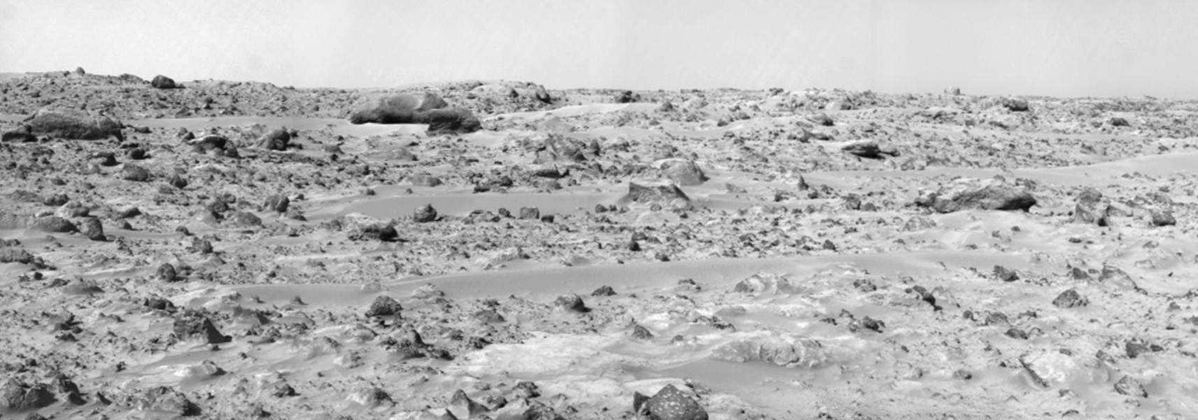 This view from NASA's Mars Pathfinder was produced in 1997 by combining 8 individual 'Superpan' scenes from the left and right eyes of the IMP camera. The large, elongated rock 'Zaphod' sits left of center in the middle distance.