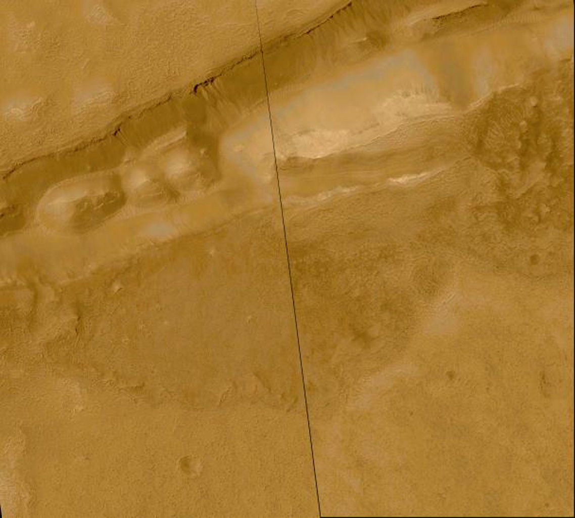 This mosaic from NASA's Mars Global Surveyor shows about 20 different gullies coming down the south-facing wall of a trough in the Sirenum Fossae/Gorgonum Chaos region of the martian southern hemisphere.