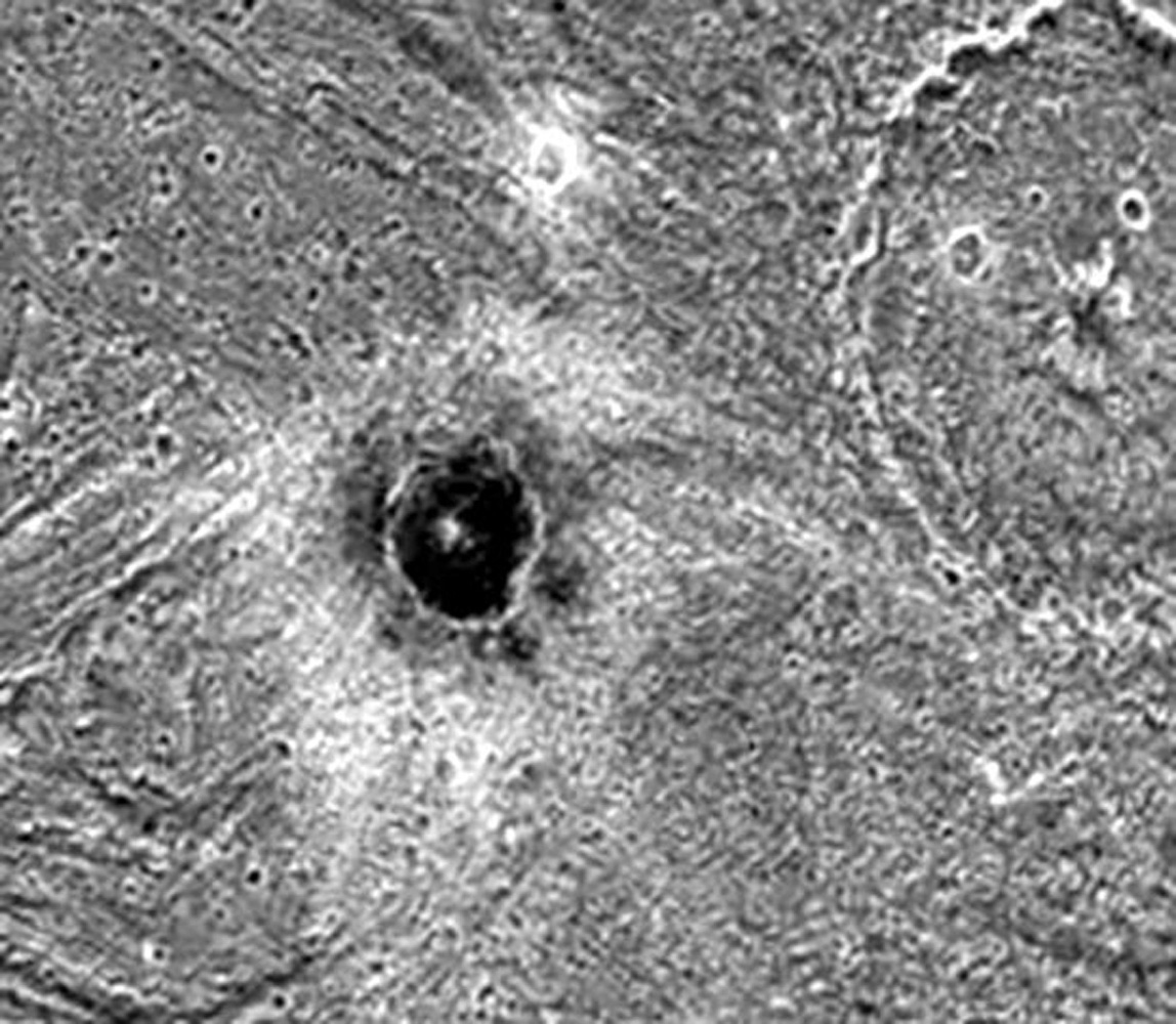 The dark-floored crater, Khensu, is the target of this image of Ganymede. The solid state imaging camera on NASA's Galileo spacecraft imaged this region as it passed Ganymede during its second orbit through the Jovian system.