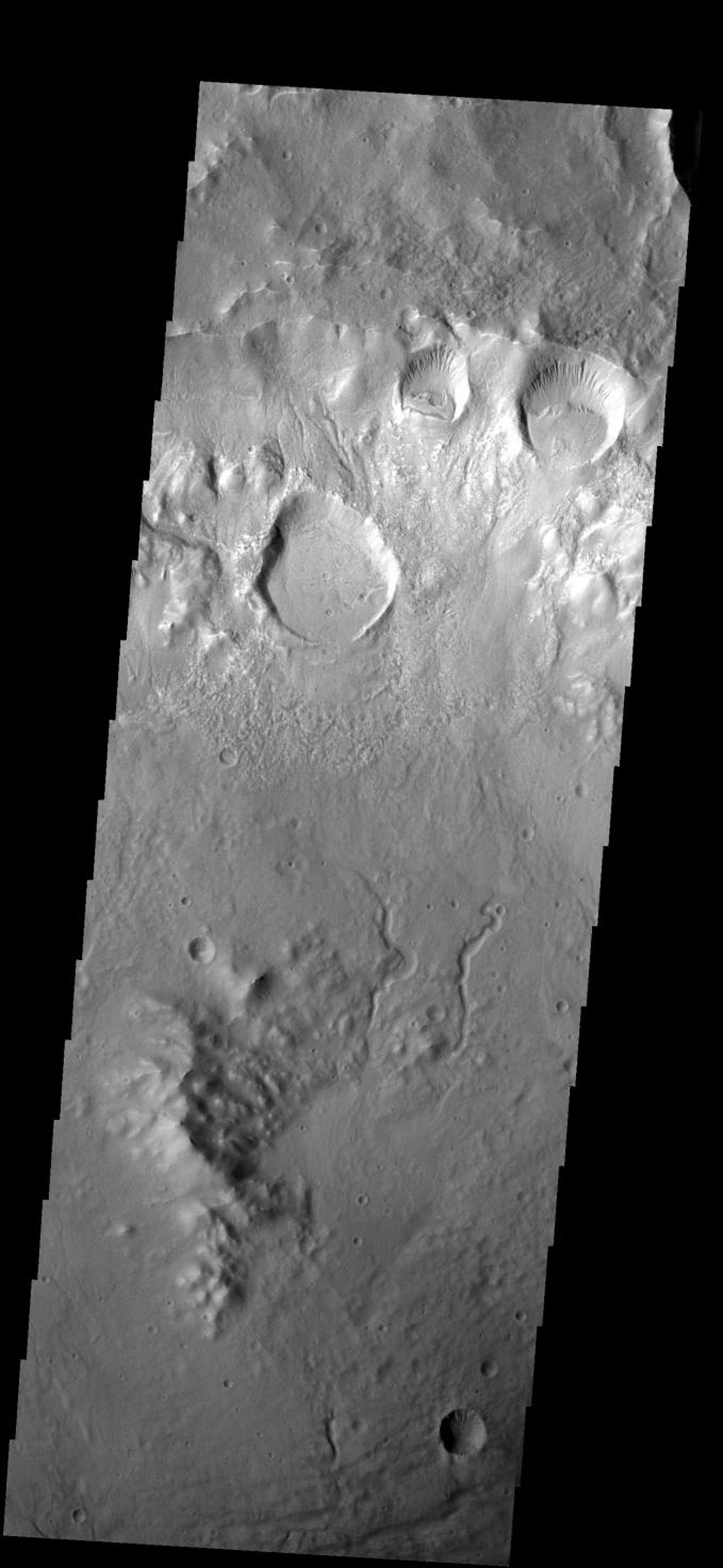 This image from NASA's Mars 2001 Odyssey shows several craters were formed on the rim of this large crater. The movement of material downhill toward the floor of the large crater has formed interesting patterns on the floors of the smaller craters.