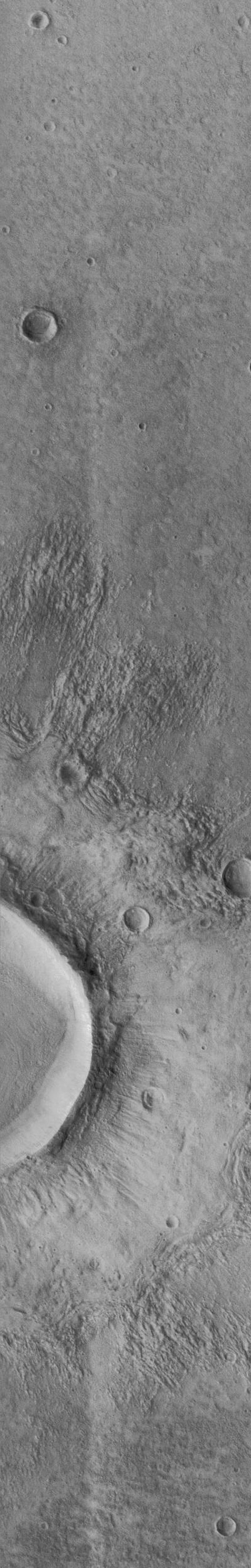 NASA's Mars Global Surveyor acquired this image of a flow ejecta crater on November 19, 1997. Flow ejecta craters are so named because the material blasted out of the crater during the impact process appears to have flowed across the surface of Mars.