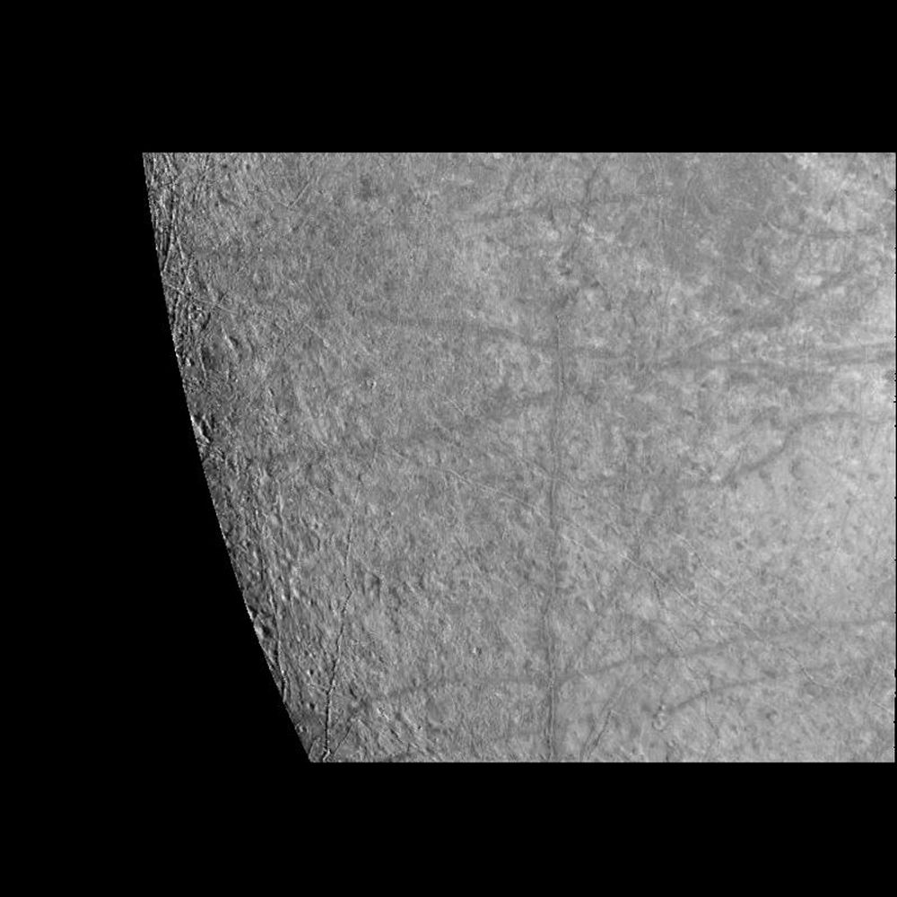 This image of Europa's surface was obtained by the Solid State Imaging (CCD) system on board NASA's Galileo spacecraft during its fourth orbit of Jupiter. Linear features with bright central stripes are seen to transect the surface of Europa.