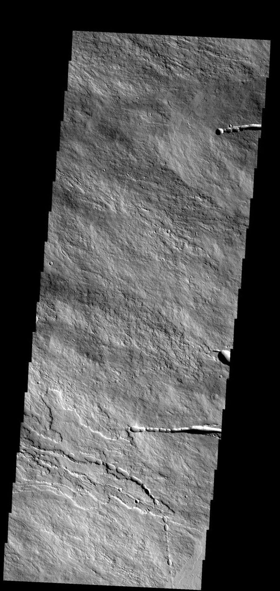 This image shows a small portion of the flank of Ascraeus Mons on Mars, taken by NASA's Mars 2001 Odyssey spacecraft.