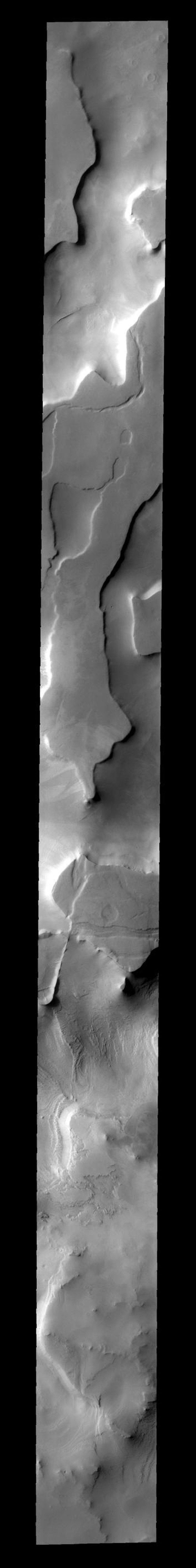 This region of plateaus near the south polar cap is called Cavi Angusti on Mars, taken by NASA's Mars 2001 Odyssey spacecraft.