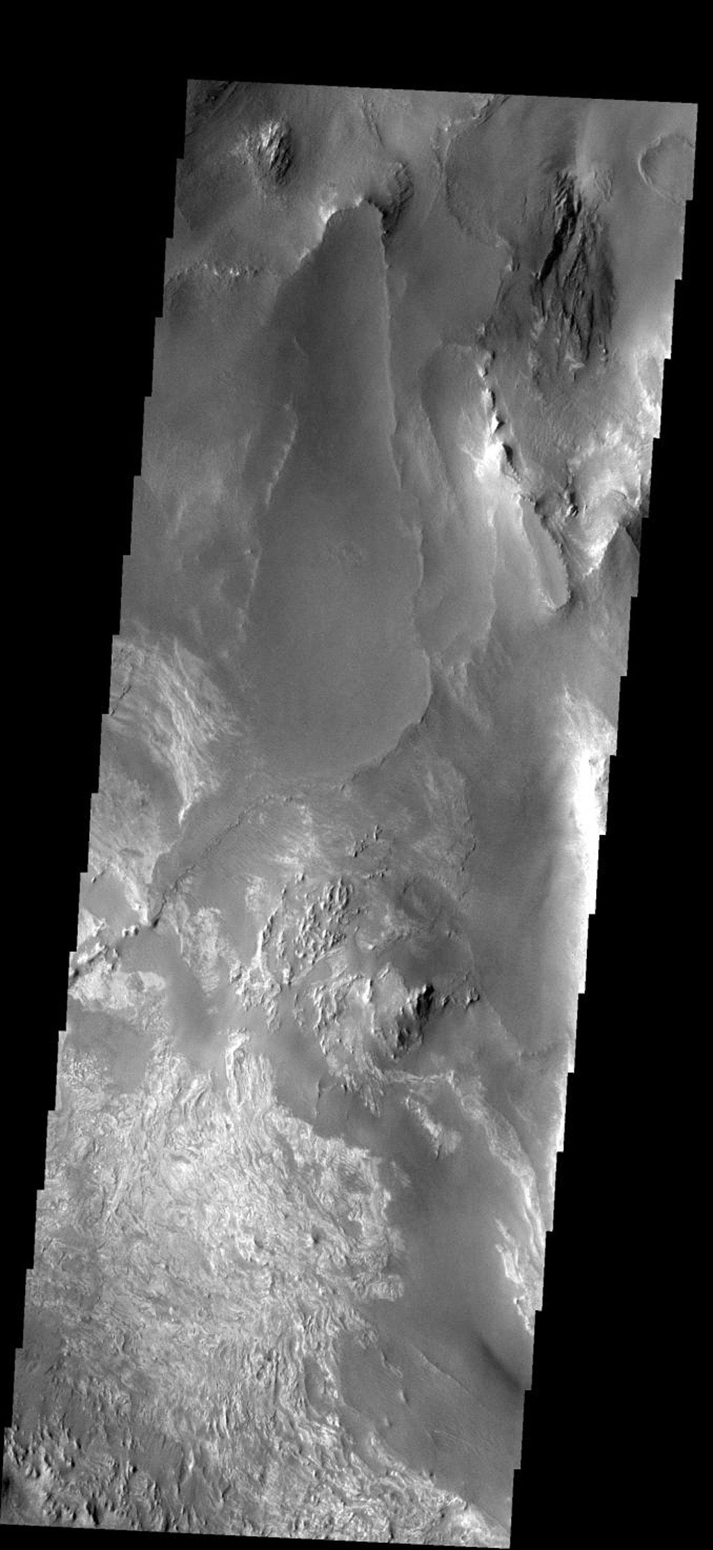 This image shows part of the floor of Melas Chasma. Layered materials and sand are common in this section of canyon on Mars, taken by NASA's Mars 2001 Odyssey spacecraft.