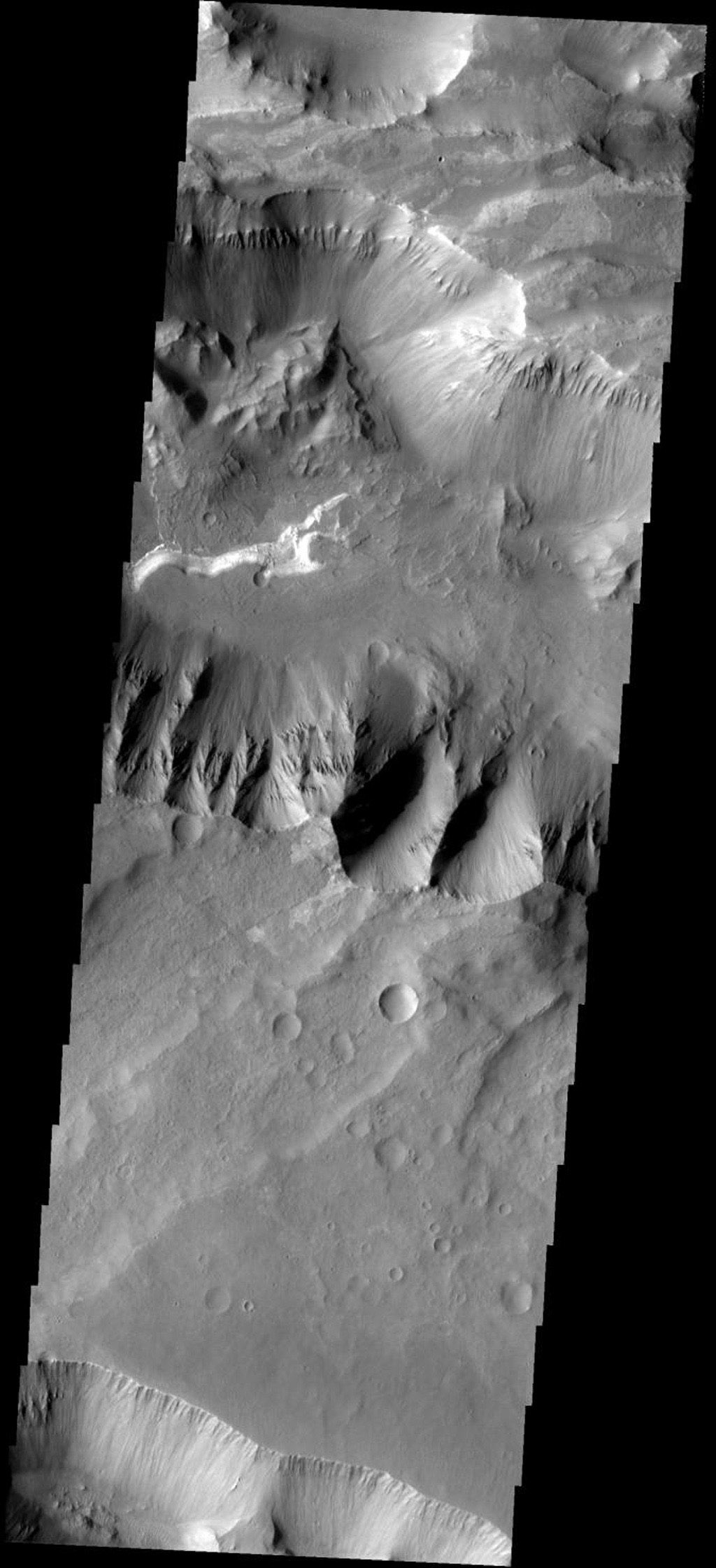 This image shows part of Coprates Chasma on Mars, taken by NASA's Mars 2001 Odyssey spacecraft.