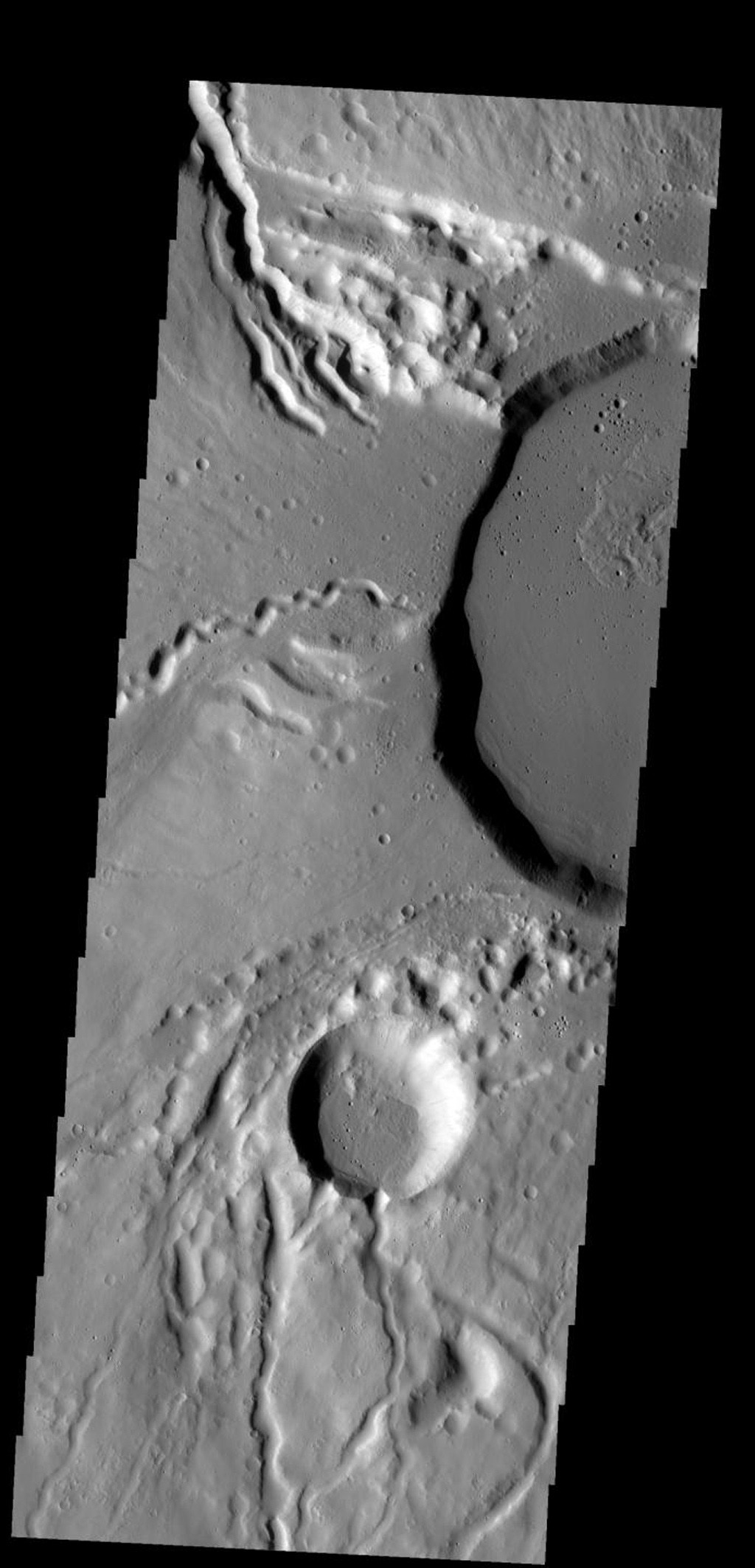 This image shows part of the summit caldera of Ceraunius Tholus on Mars. Channels are common on the flanks of this volcano on Mars, taken by NASA's Mars 2001 Odyssey spacecraft.