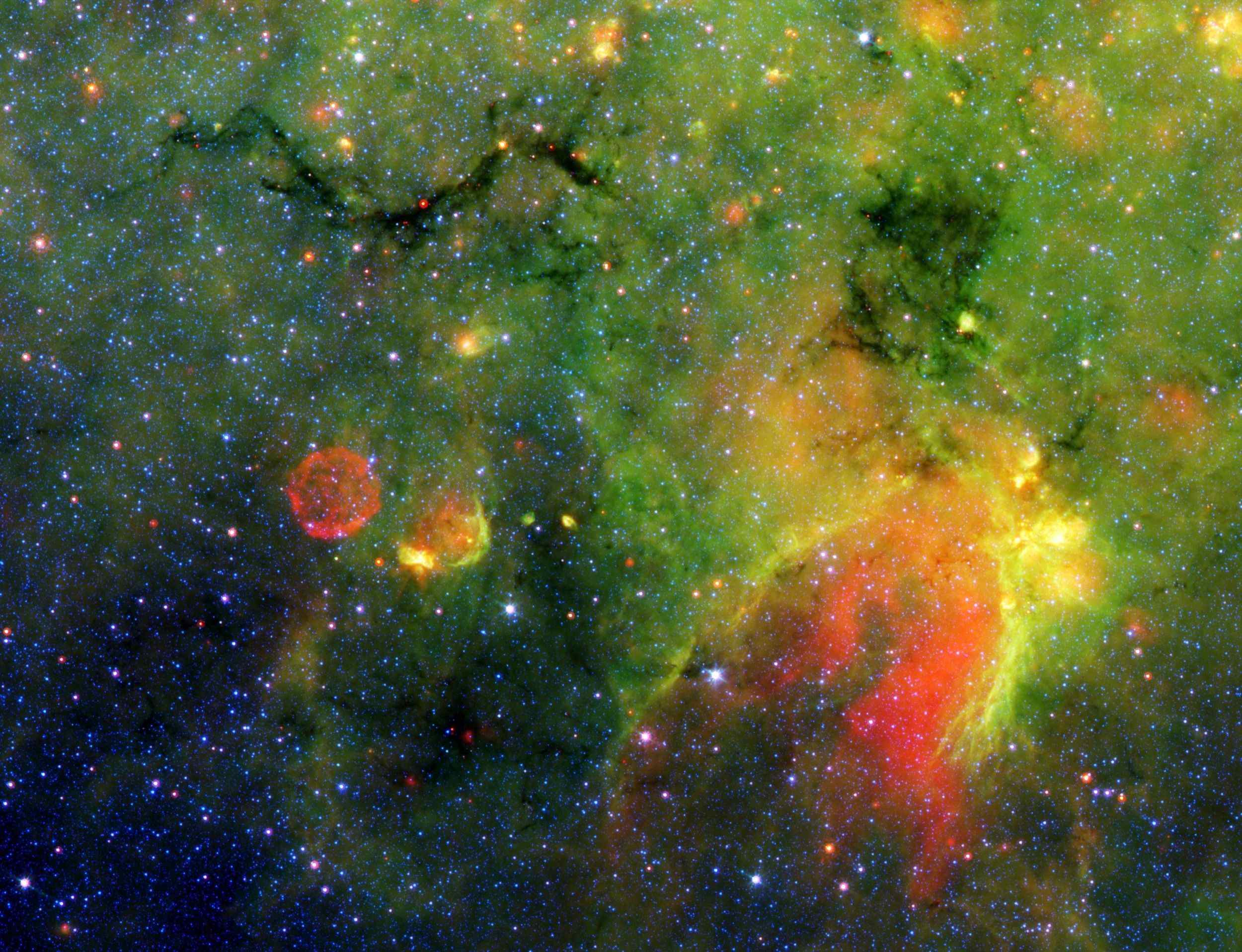 This infrared image from NASA's Spitzer Space Telescope shows what astronomers are referring to as a 'snake' (upper left) and its surrounding stormy environment.