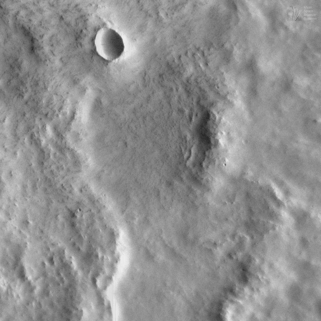 This image acquired on August 7, 1998 by NASA's Mars Global Surveyor shows ejecta from a nameless crater on the martian surface.