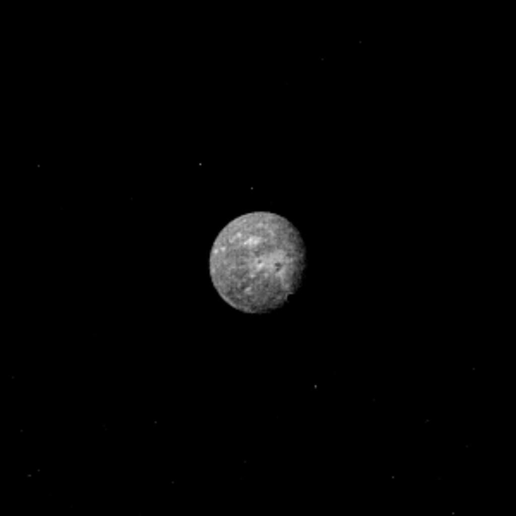 Uranus' outermost and largest moon, Oberon, is seen in this image, obtained by NASA's Voyager 2 on Jan. 22, 1986. Oberon displays several distinct highly reflective (high-albedo) patches with low-albedo centers.