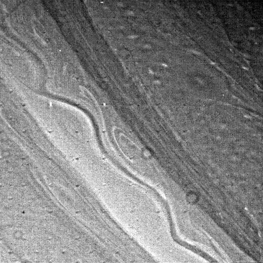 The extensive ribbonlike cloud structure in Saturn's atmosphere is visible in this image from NASA's Voyager 2, obtained Aug. 23, 1980 from a range of 2.5 million kilometers (1.6 million miles).