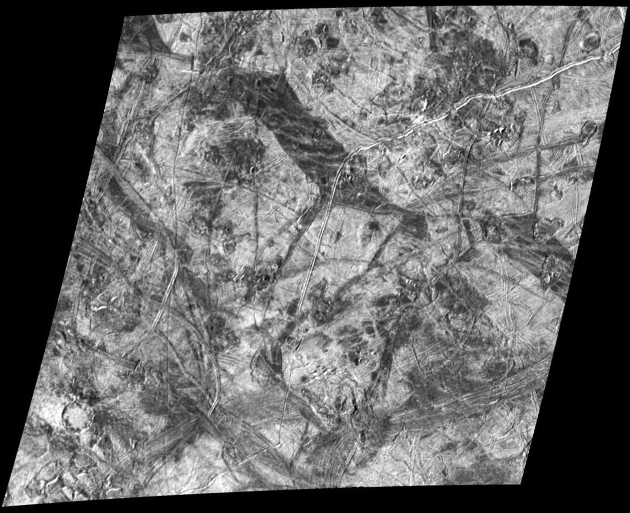 This complex area on the side of Europa which faces away from Jupiter shows several types of features which are formed by disruptions of Europa's icy crust. North is to the top of the image, taken by NASA's Galileo spacecraft.