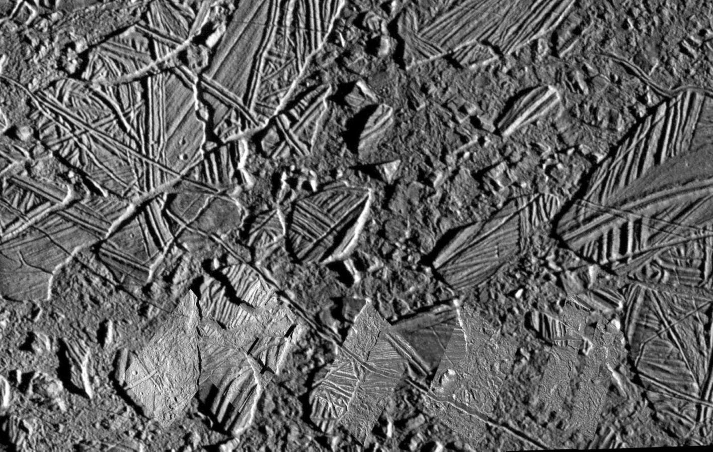 This mosaic of the Conamara Chaos region on Jupiter's moon, Europa, clearly indicates relatively recent resurfacing of Europa's surface. The background image in this picture was taken during NASA's Galileo spacecraft's sixth orbit of Jupiter.