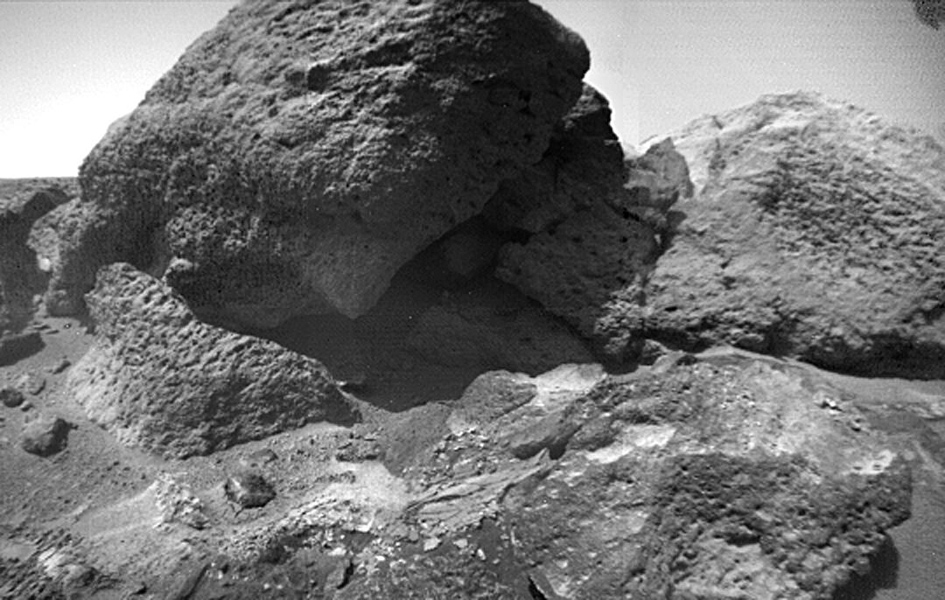 This close-up image of 'Shark,' in the Bookshelf at the back of the Rock Garden, was taken NASA's Sojourner Rover on Sol 75. Also in the image are 'Half Dome' (right) and 'Desert Princess' (lower right). Sol 1 began on July 4, 1997.
