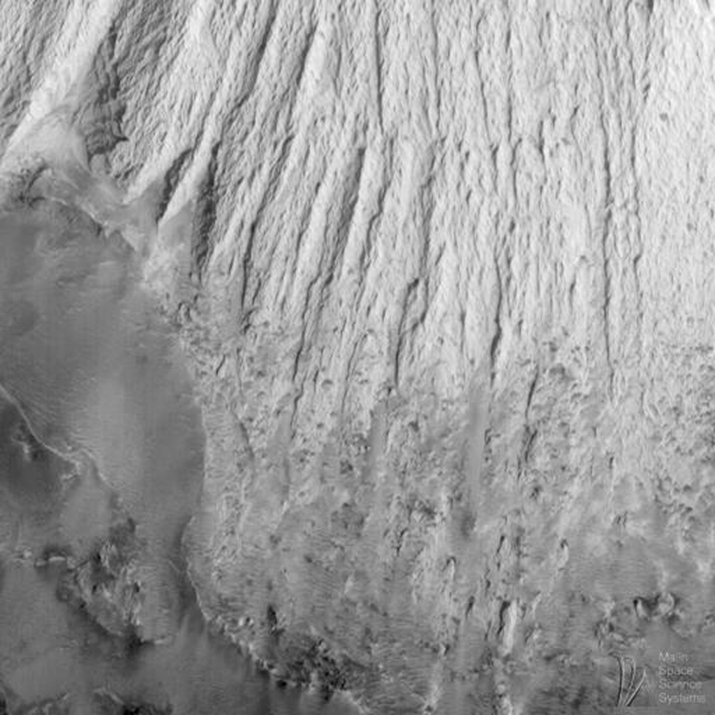 NASA's Mars Global Surveyor acquired this image on April 20, 1998. Shown here are layered materials in the walls and on the floors of the enormous Valles Marineris system.